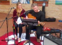 Staff members performing at Bierley's Big Blue Music Festival