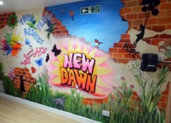 The new mural in the entrance hall to New Dawn Ward