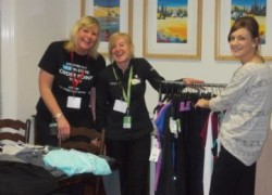 Occupational Therapist, Rebecca Gould, helping staff from George prepare the first 'Pop Up Shop'