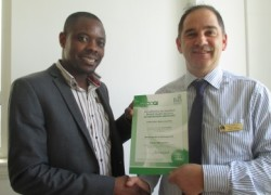 Hospital Manager David Colyer presents Sandford Ward Manager Joseph Muguti with Sandford's AIMS certificate