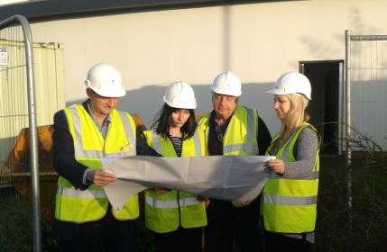 Hospital Manager Mark Varney and members of the Derby team study the plans for the new flatlets