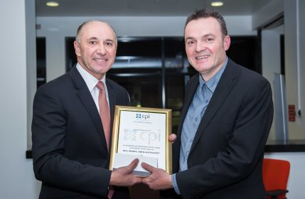 Nick Horne (right) receiving his award from the CPI's Martyn Dadds