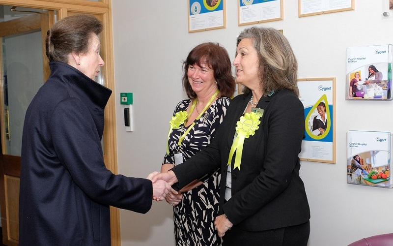 The Princess Royal talking to Julia Scott and Dr Patricia McClure of the College of Occupational Therapists