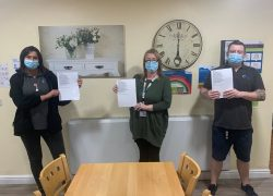 Staff members at Cygnet Aspen Clinic holding a copy of the poem