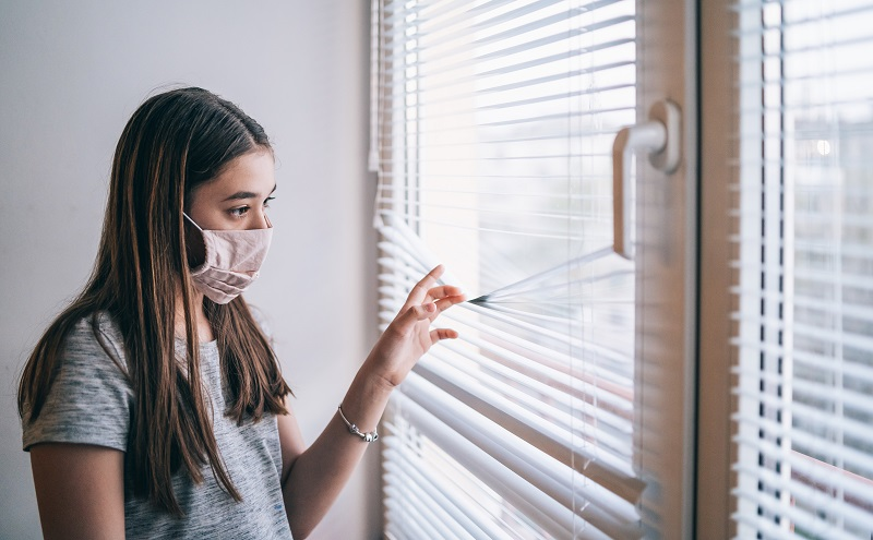 Girl in isolation at home during virus